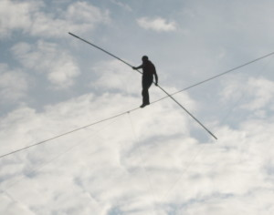 Man walking on a tight rope